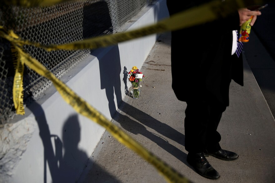 Flowers are placed near the site of the San Bernardino shooting that took place Wednesday. Groups that keep tabs on mass shootings in the U.S. have different definitions of a mass shooting, resulting in wildly different figures.