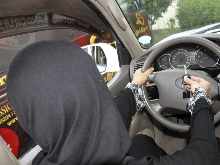 A Saudi woman poses in this picture to illustrate driving a car in Jiddah as part of a June 2011 protest. An advisory council recently recommended for the first time lifting a ban on female drivers.