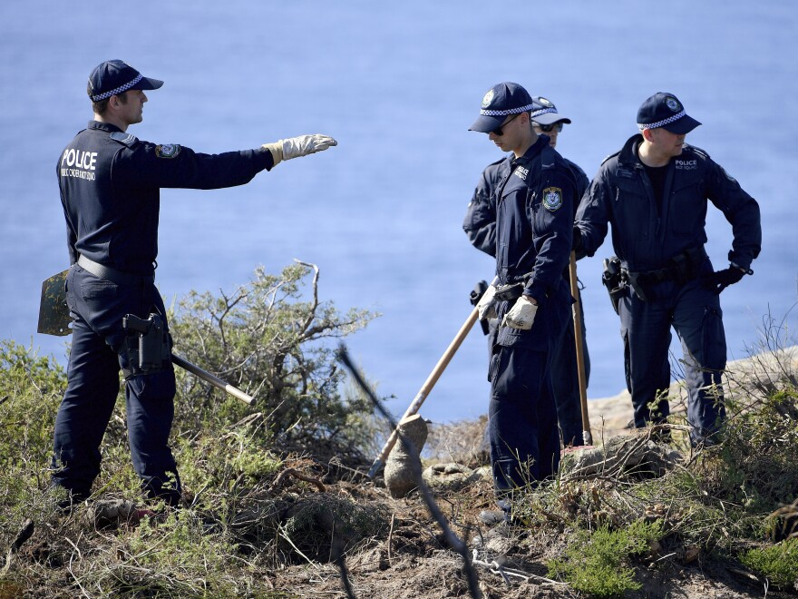 Police search a headland in Sydney, Australia, on Tuesday, following an arrest in relation to the death of a man in 1998. More than 30 years after Scott Johnson died after falling off a cliff in Sydney, authorities have charged a man with his death, in an apparent gay hate crime that police believe was one of many over several decades in Australia's largest city.