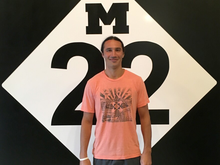 Matt Myers started the M22 business with his brother, Keegan. They trademarked the logo in 2007, but now the Michigan attorney general is challenging the trademark in court.