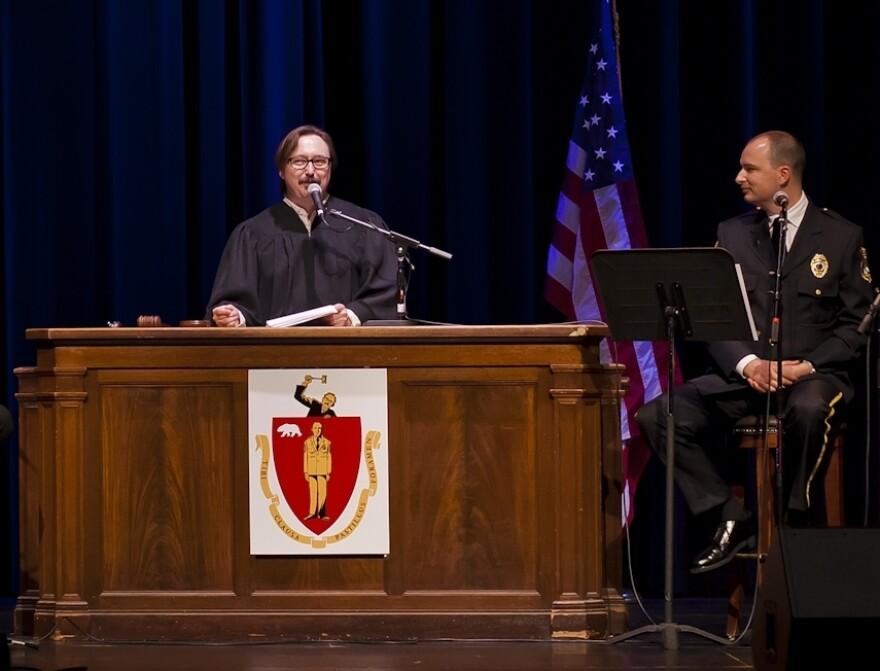 John Hodgman, left, presides over a live taping of the <em>Judge John Hodgman</em> podcast, as Jesse Thorn looks on.