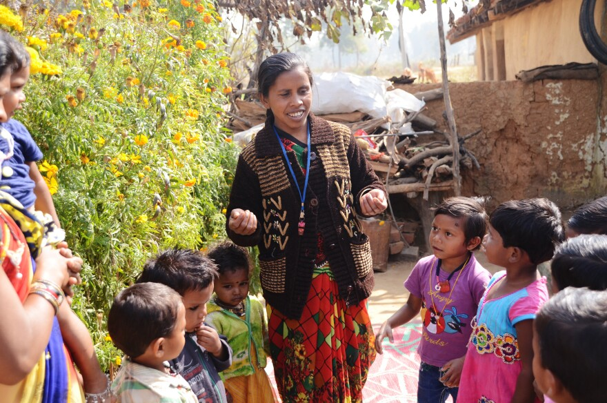 """Nursery worker Shivkumari Pate leads children in a learning song. Pate works with the nonprofit <a href=""""http://www.jssbilaspur.org/activities/creches.php"""">Jan Swasthya Sahyog</a>, which developed the first network of community nurseries."""
