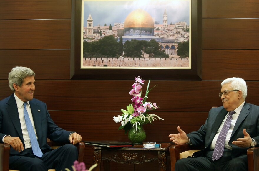 """Secretary of State John Kerry meets with Palestinian President Mahmoud Abbas in Ramallah, West Bank, on Friday. Shortly afterward, Kerry announced a """"basis"""" for the Israelis and Palestinians to resume peace negotiations."""