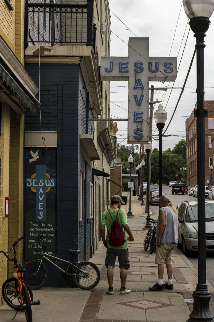 A cross hangs above The Mission on 4th Street in Clarksburg, W.Va.