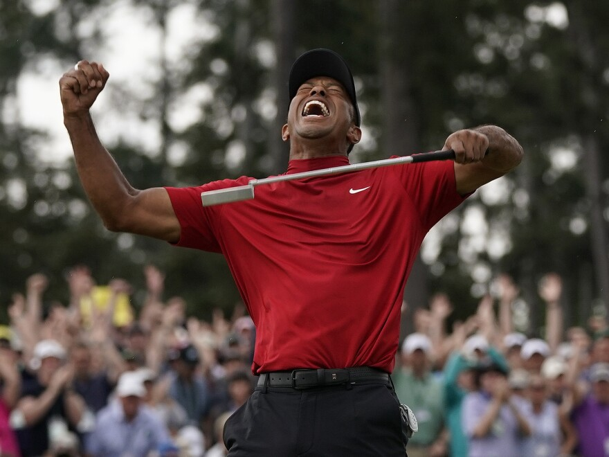 Tiger Woods reacts as he wins the Masters Tournament last year in Augusta, Ga.