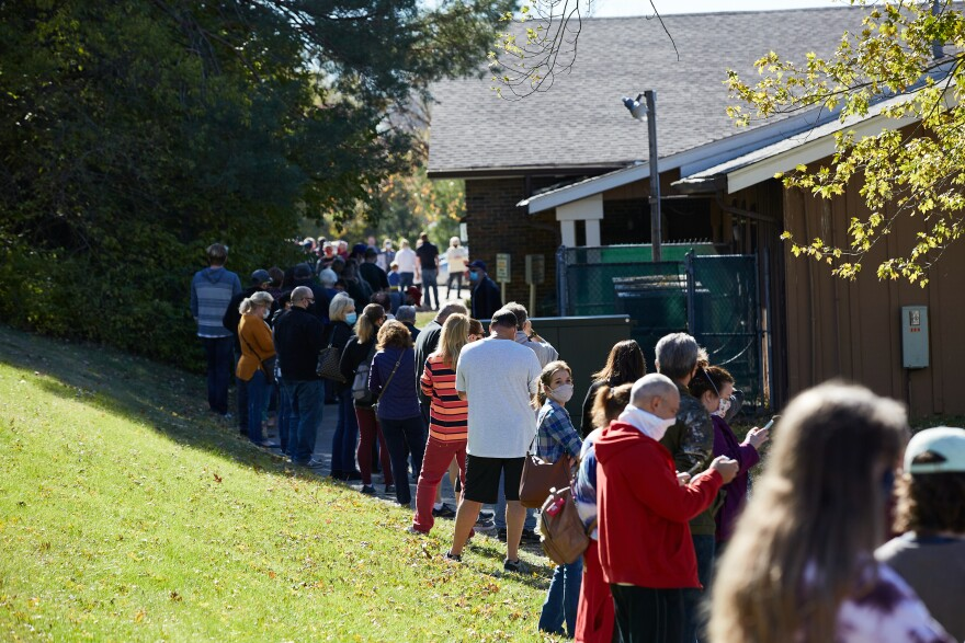 Voters wait in lines outside a St. Louis County polling site at the Ballwin Golf Course and Events Center on Election Day Tuesday, November 3, 2020.