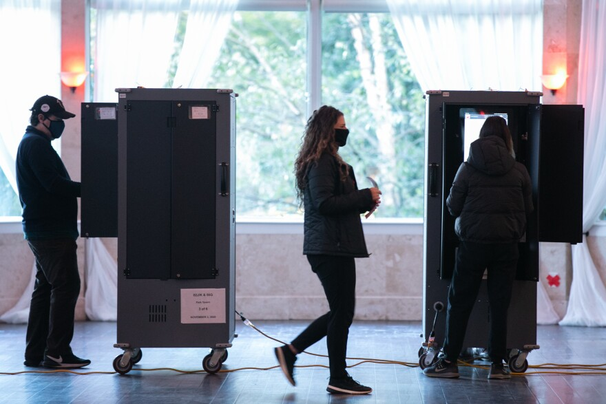 Voters cast ballots at the Park Tavern polling station on Tuesday in Atlanta. Nearly 95% of Georgia's estimated ballots have been reported, but metro Atlanta is currently the holdout area.