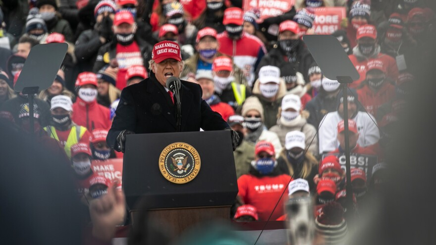 President Trump addresses supporters Sunday at a campaign rally in Macomb County, Mich.
