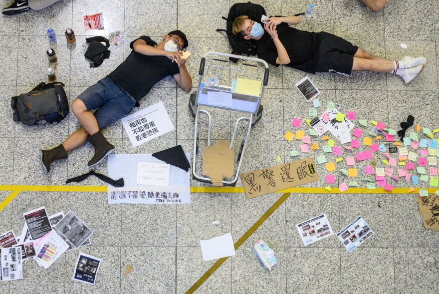 Protesters rest at the airport in Hong Kong.