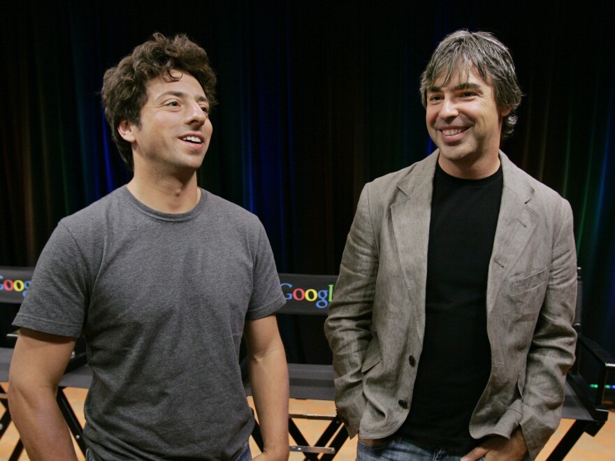 Google co-founders Sergey Brin (left) and Larry Page announced Tuesday they are stepping down from their leadership roles but will remain board members of Alphabet, Google's parent company.