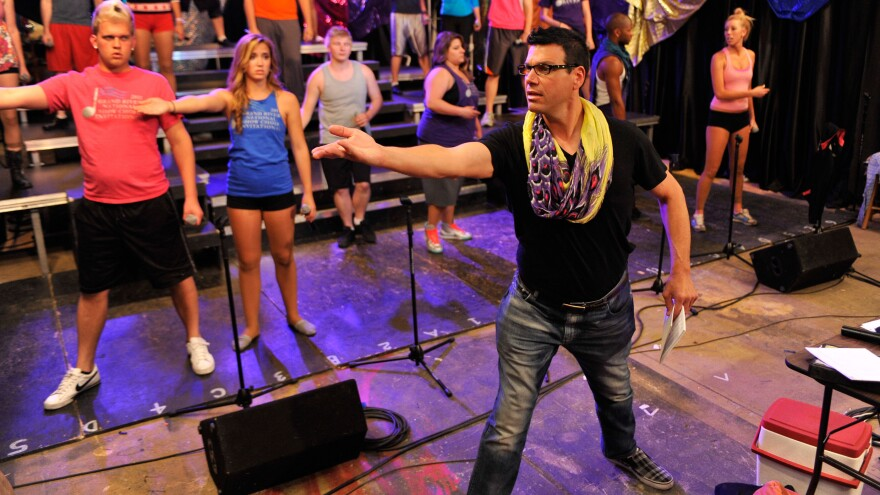 Director Rob takes charge of a rehearsal in VH1's <em>Off Pitch</em>.