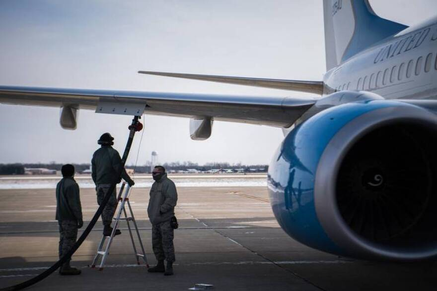 Airman First Class Anthony Uelk, on the ladder, along with fellow 932nd Airlift Wing flight line crew chiefs, refuel a C-40 in preparation for a launch at Scott Air Force Base, Illinois.