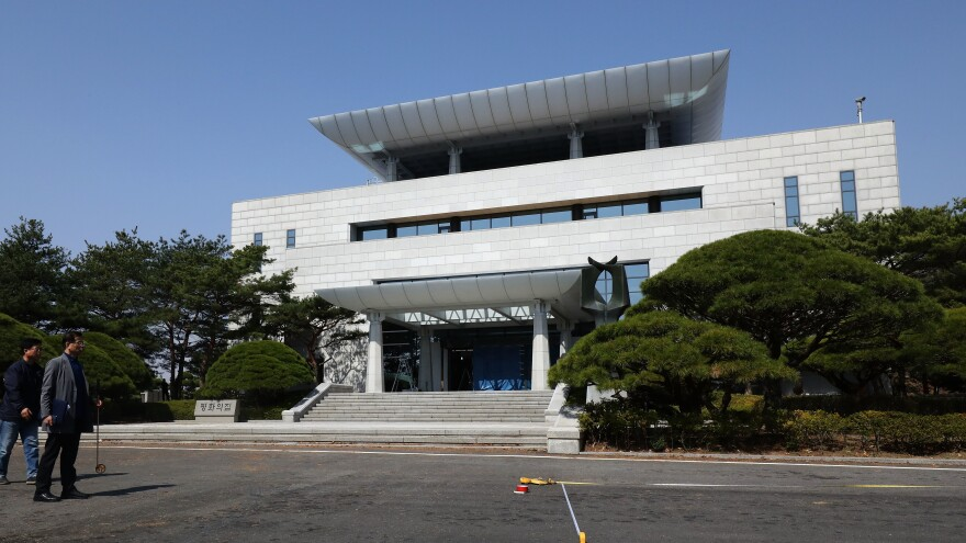 South Korean officials prepare for inter-Korean summit in front of the Peace House. Kim Jong Un and Moon Jae-in are scheduled to meet there Friday.