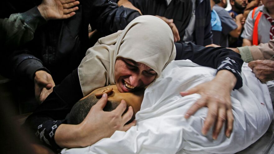 A mother mourns her 25-year-old Palestinian son Tuesday in Beit Lahia, in the northern Gaza Strip. Israel said it had carried out an airstrike in the area amid an escalation of violence between Israeli troops and Palestinian militants.