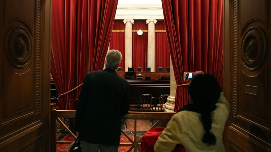 Tourists look into the chamber of the U.S. Supreme Court in February 2016.