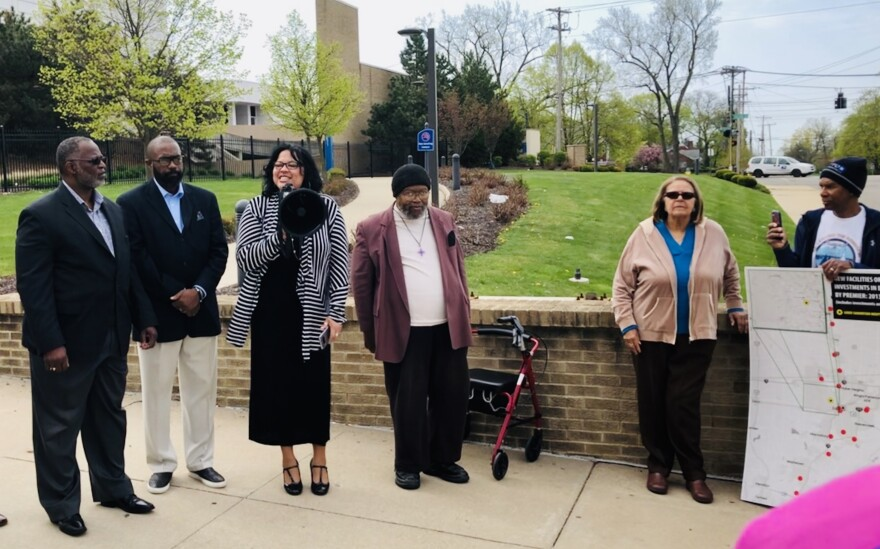 Father Benjamin Speare-Hardy (left), Rev. Rockney Carter, Rev. Merritt Worthen, and Bishop Richard E. Cox (fourth from the left); with the Clergy Community Coalition address a small gathering in front of the former Good Samaritan Hospital.
