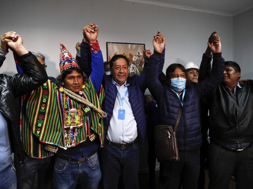 Luis Arce (center), Bolivian presidential candidate in Evo Morales' party, and running mate David Choquehuanca (second right) celebrate during a news conference where they claim victory after general elections in La Paz, Bolivia, Monday.