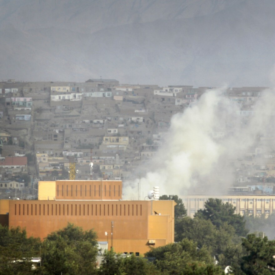 Dust rises after firing by Taliban militants in Kabul, Afghanistan, after Taliban insurgents fired rocket-propelled grenades and assault rifles at the U.S. Embassy earlier this month.