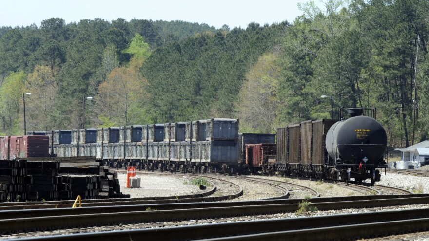 """Containers loaded with tons of sewage sludge sit simmering in the sun last week in Parrish, Ala. More than two months after the """"poop train"""" rolled in from New York City, Parrish Mayor Heather Hall says the material is leaving town."""