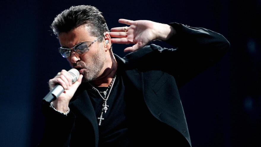 George Michael performs during a concert in Amsterdam in 2007.
