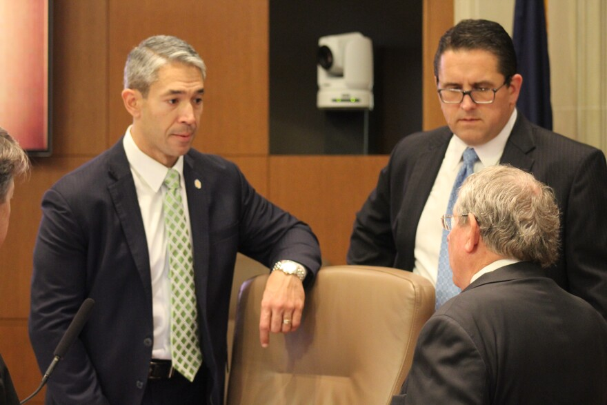 San Antonio Mayor Ron Nirenberg and City Manager Erik Walsh (right) talk with a constituent before an April city council meeting.