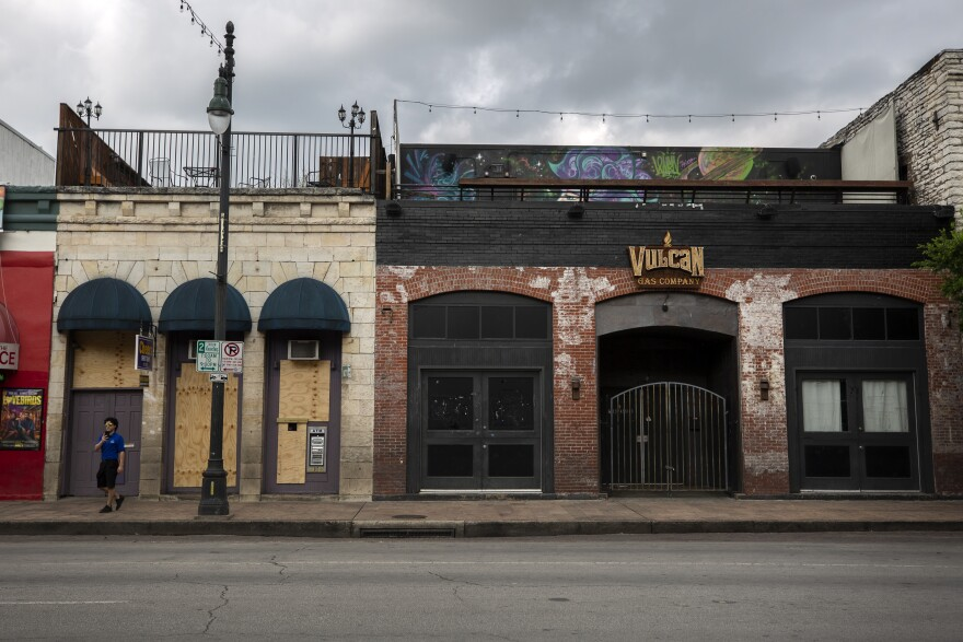 Bars and restaurants on Sixth Street are closed and boarded up during the coronavirus pandemic.