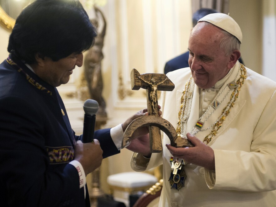 Bolivian President Evo Morales presents Pope Francis with a crucifix carved into a wooden hammer and sickle in La Paz, Bolivia, on Wednesday.