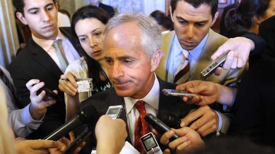 Sen. Bob Corker, R-Tenn. (center), talks to reporters on Capitol Hill. He decided Tuesday not to seek a third term. Corker is the first Senate retirement of the 2018 election cycle.