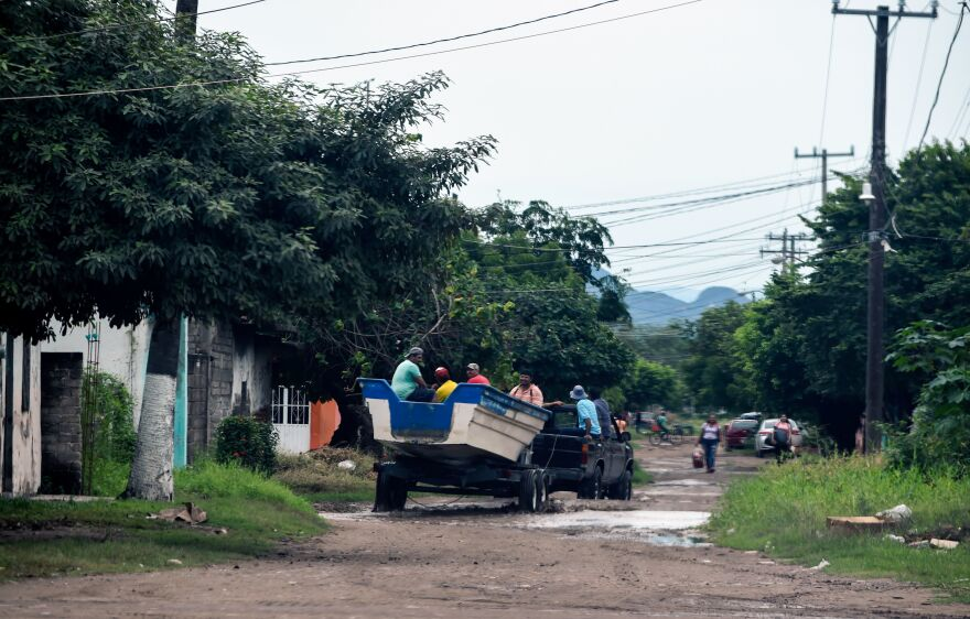People being evacuated in Teacapan, Sinaloa state, Mexico, on Monday.