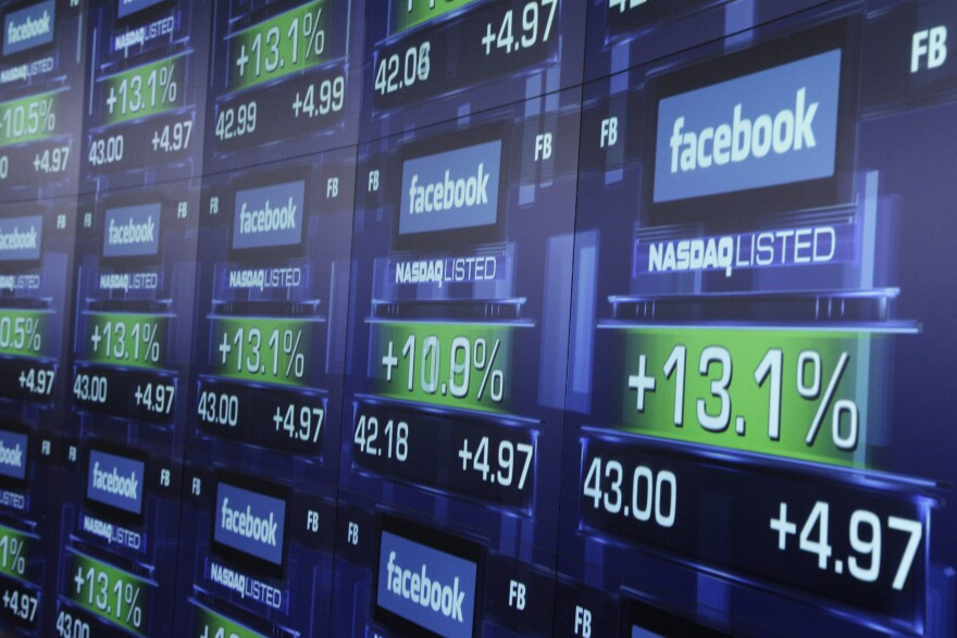Electronic screens show the price of Facebook shares after they began trading May 18, 2012, in New York. A technical problem on the Nasdaq marred Facebook's much-heralded IPO.