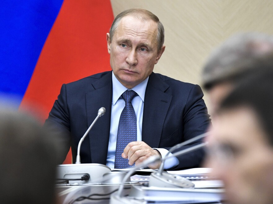 Russian President Vladimir Putin leads a Cabinet meeting at the Novo-Ogaryovo residence outside Moscow on Wednesday.