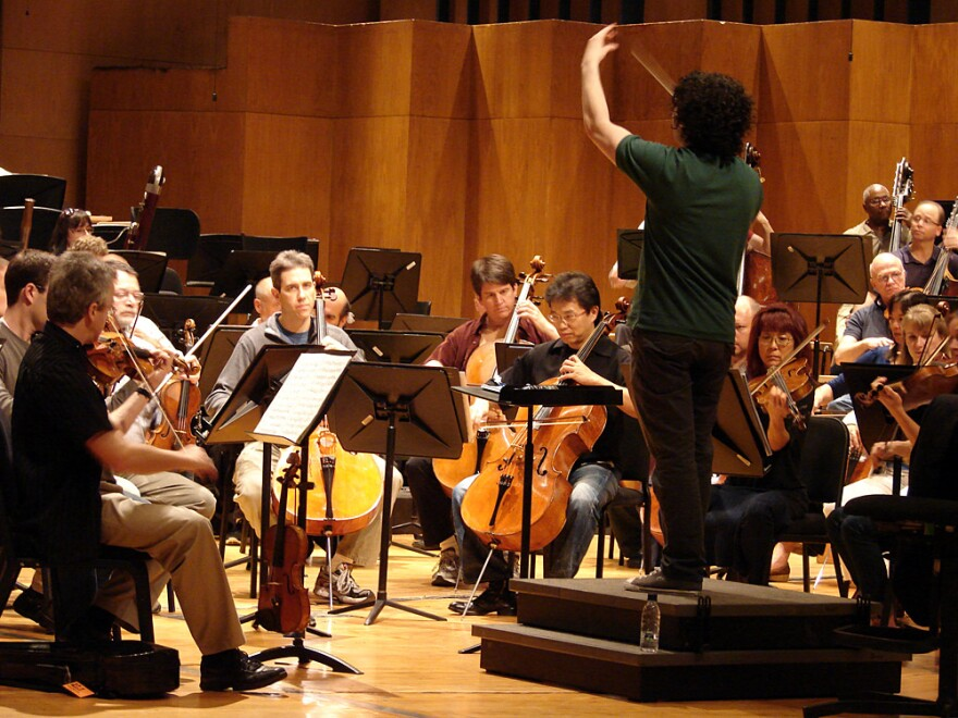 Conductor Gustavo Dudamel leads the L.A. Philharmonic in a rehearsal of Mahler's Symphony No. 4, on tour last month in Caracas, Venezuela.