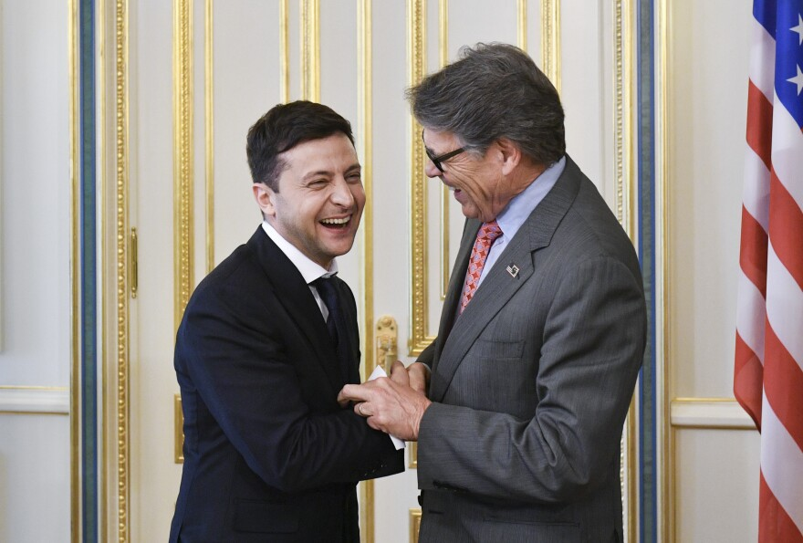 Ukrainian President Volodymyr Zelenskiy (left) and U.S. Energy Secretary Rick Perry share a joke during a meeting in Kyiv, Ukraine, this past May.
