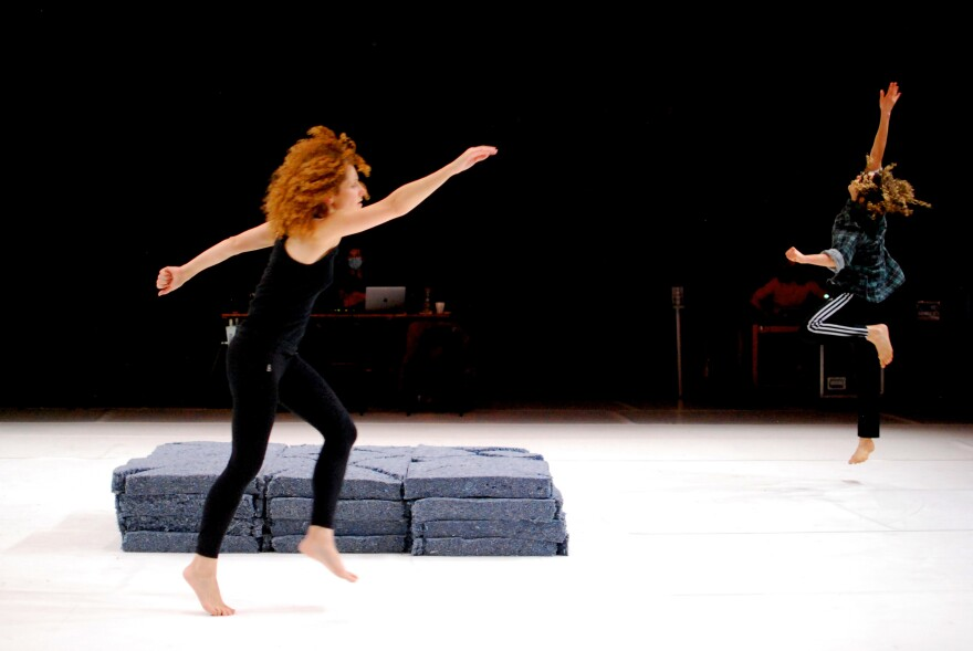 Dancer Liz Santoro, who moved to Paris 9 years ago, says France's special unemployment system for performing artists and technicians has made it possible for her to continue her work, despite a year of postponed projects and aborted plans. She's pictured above in a rehearsal with Jacquelyn Elder in November 2020.
