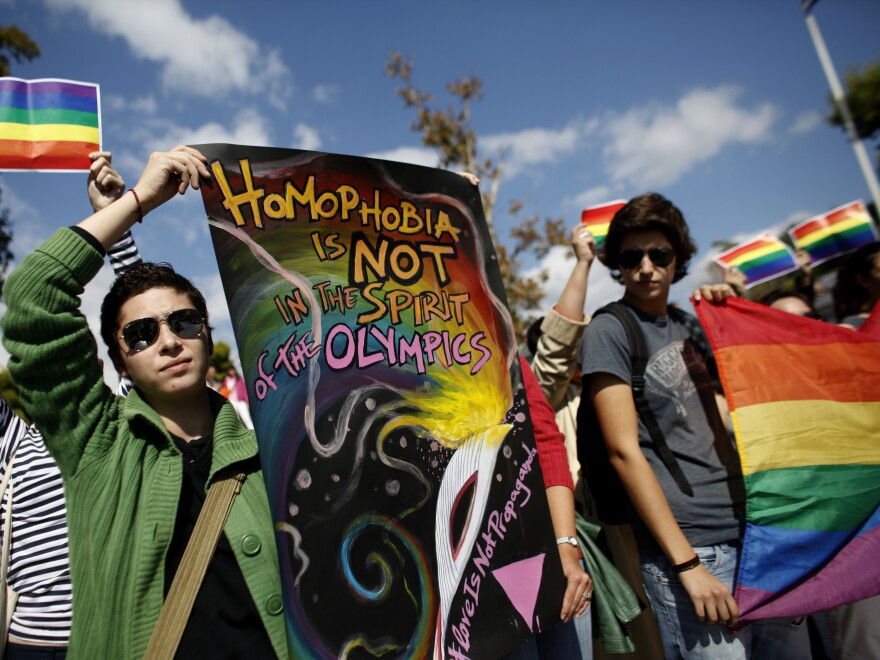 Activists protest an event ahead of the handover ceremony of the Olympic flame, in Athens, Greece, on Oct. 5.