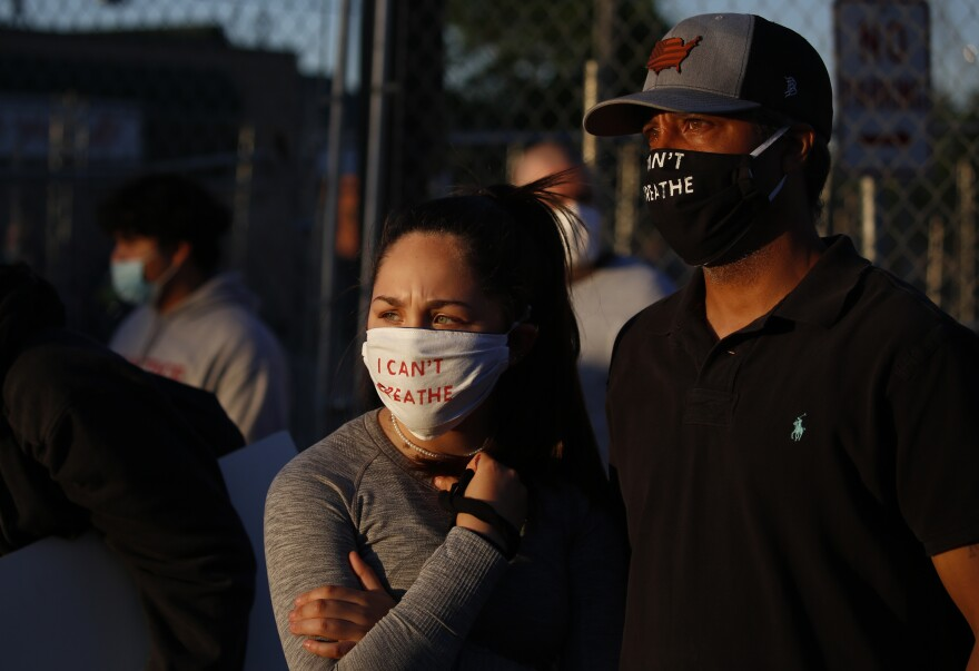 "A couple wears masks that read ""I Can't Breathe"" during a demonstration in Minneapolis on Saturday."