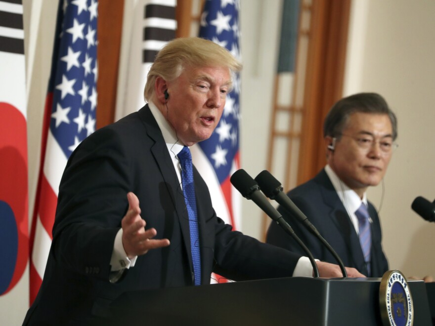President Trump speaks as South Korean President Moon Jae-in looks on in a joint news conference at the Blue House in Seoul, South Korea, on Tuesday.