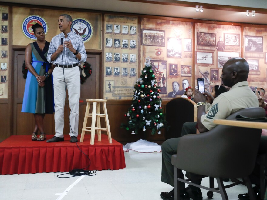 President Obama, joined by first lady Michelle Obama, thanks service members and their families at Marine Corps Base Hawaii, in Kaneohe Bay, Christmas Day.