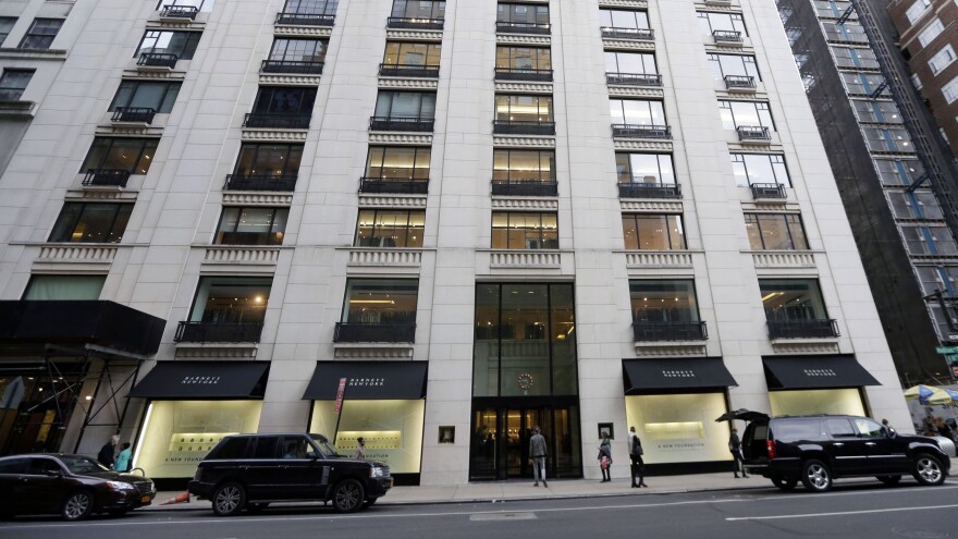 Barneys has agreed to a settlement, including a $525,000 fine, over charges of racial profiling at its New York department store.