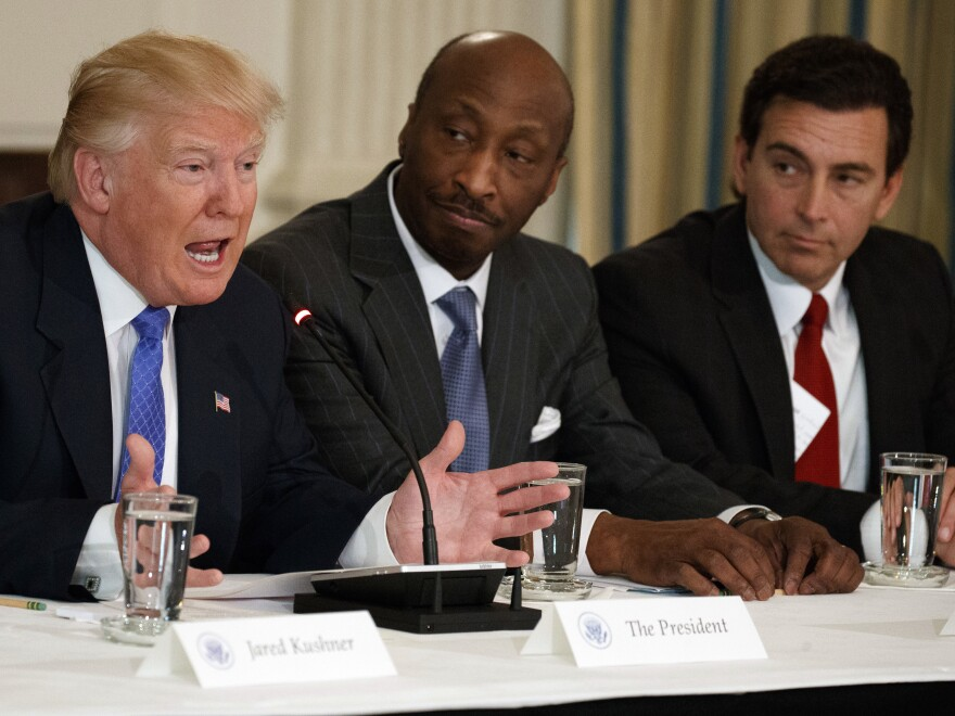 President Trump speaks during a meeting with manufacturing executives at the White House in February, including Merck's Kenneth Frazier (center) and Ford's Mark Fields. Frazier has resigned from the president's manufacturing council.