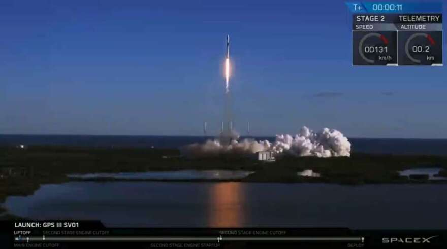 A rocket takes off amid a plume of smoke from Cape Canaveral.