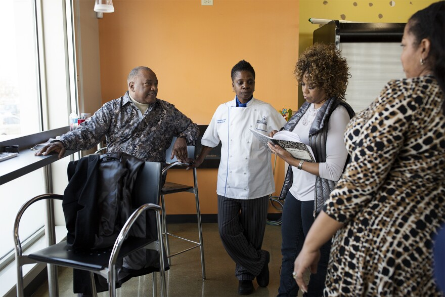 Sterling Moody makes plans for the store's opening with resident chef Marca Rottnek, center, and store manager Evelyn Fluellen.