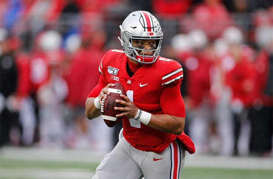 Ohio State quarterback Justin Fields plays against Wisconsin during an NCAA college football game Saturday, Oct. 26, 2019, in Columbus, Ohio.