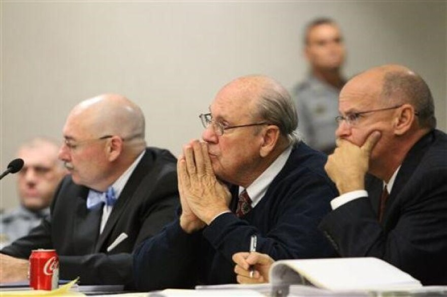 Former Tampa Police captain Curtis Reeves, Jr., (center), sits beside his defense attorneys Dino Michaels (left) and Richard Escobar as they listen to his taped interview by detectives during his bond reduction hearing in Dade City in 2014.