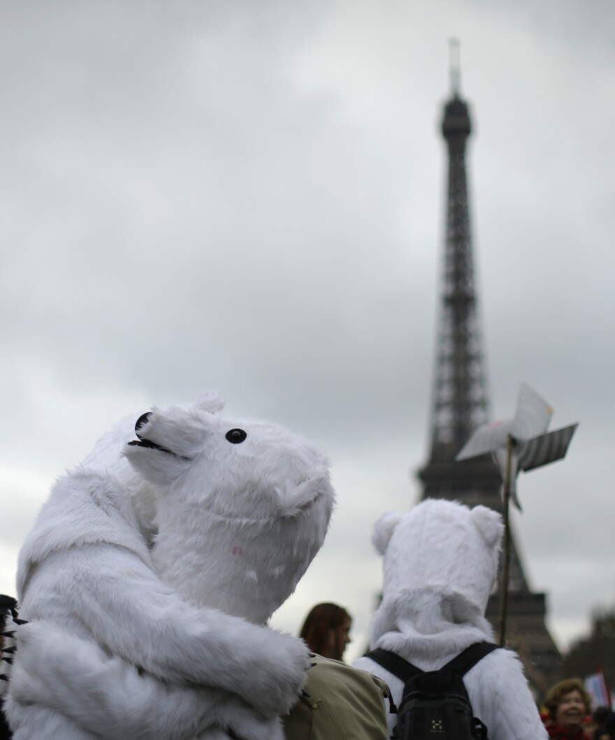 Costumed activists demonstrate near the Eiffel Tower, in Paris, on Saturday during the the United Nations Climate Change Conference.