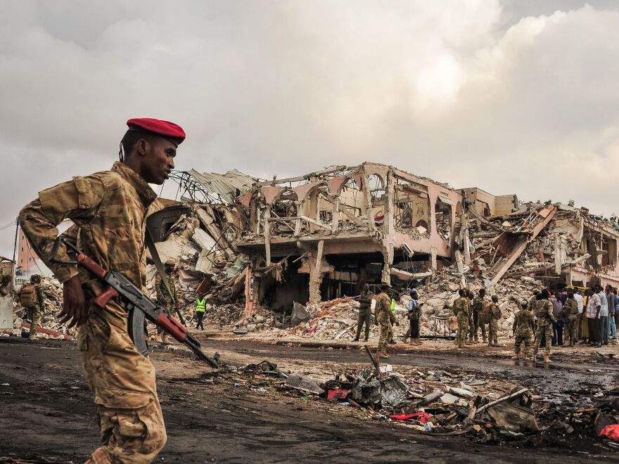 Somali soldiers patrol on the scene of the explosion of a truck bomb in the center of Mogadishu, on Oct. 15, 2017. A truck bomb exploded outside a hotel at a busy junction in Somalia's capital Mogadishu on Oct. 14, 2017, causing widespread devastation