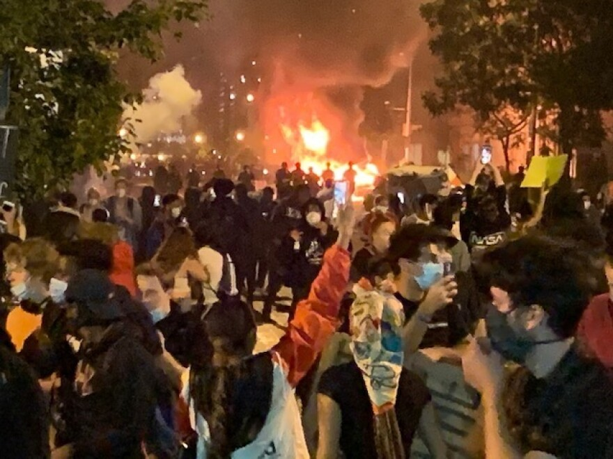 A car apparently set on fire by protesters burns near the White House Sunday night.