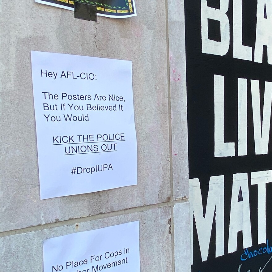 "Protesters added a sign on the AFL-CIO building wall saying, ""Hey AFL-CIO, The Posters Are Nice, But If You Believed It You Would Kick The Police Unions Out."""