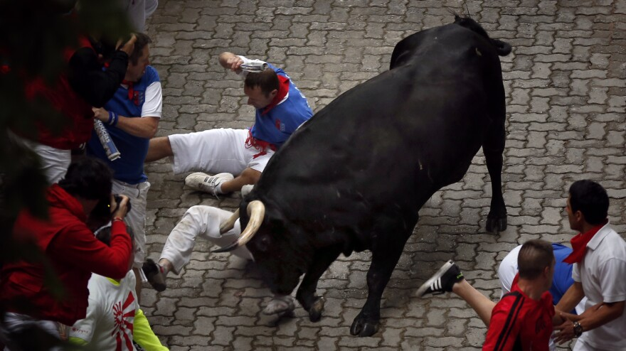 U.S. runner Bill Hillmann is gored on his right leg during the running of the bulls of the San Fermin festival, in Pamplona, Spain, on Wednesday.