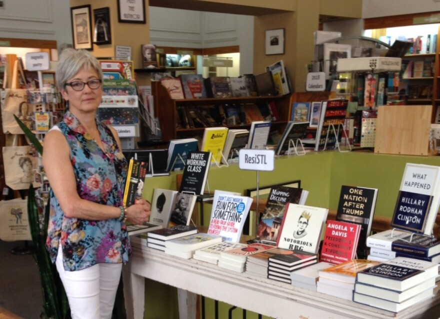 Kris Kleindienst, co-owner of Left Bank Books, stand next to the ResiSTL display table.